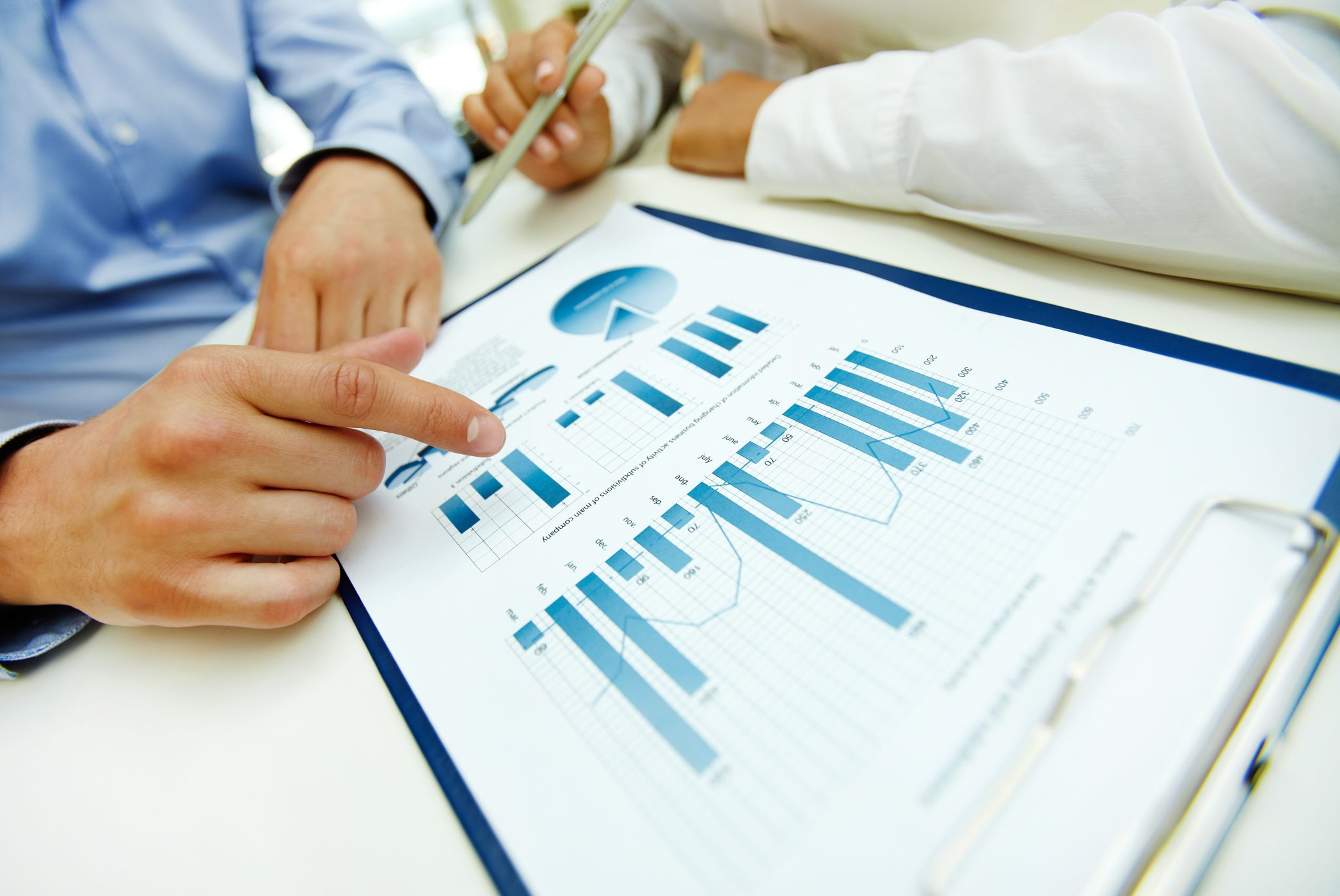 14442056 - close-up of graphs and charts analyzed by business people
